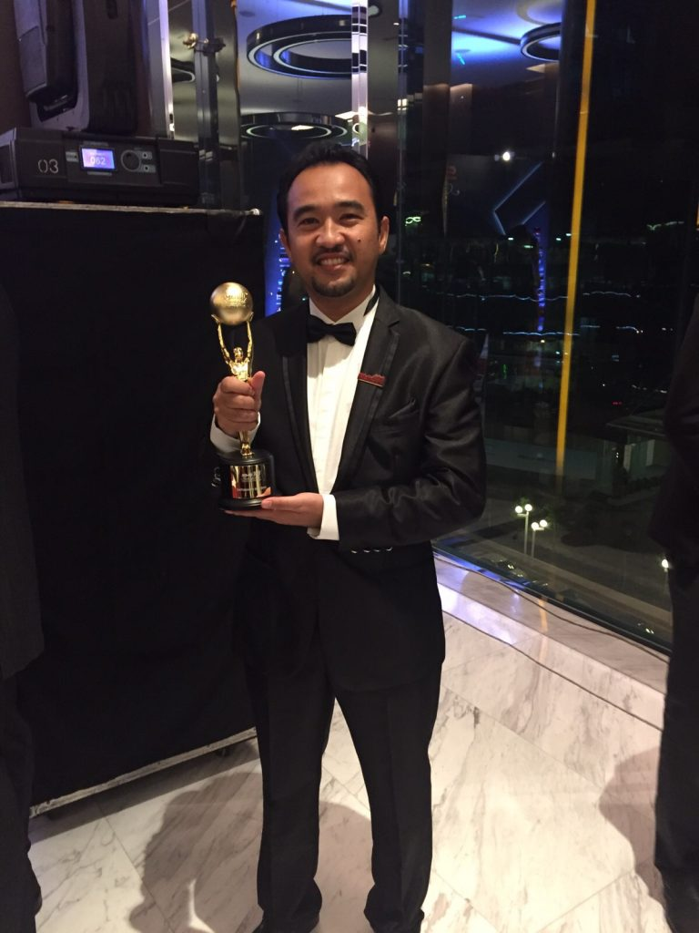 Captain Ahmad Imran with the gold-plated trophy